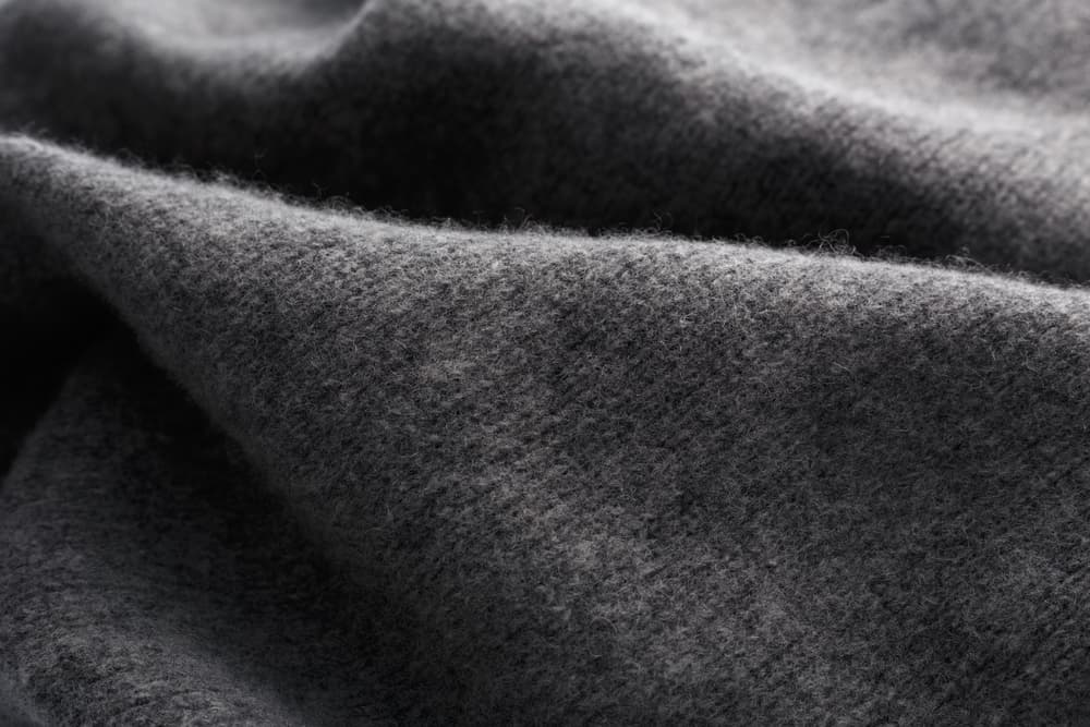 Close-up of a gray wool fabric.