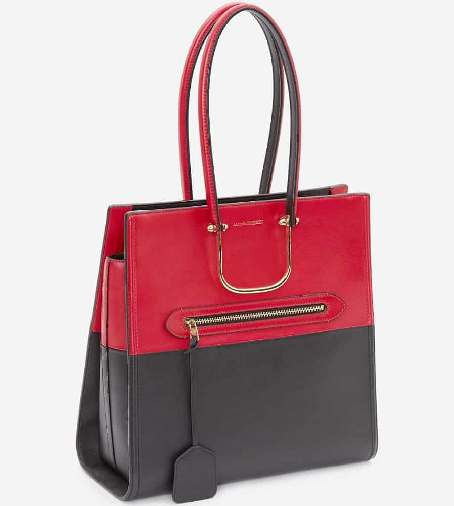The Tall Story handbag in black and Welsh red from Alexander McQueen.