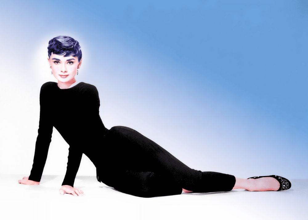 Audrey Hepburn wearing black long sleeves and pants.