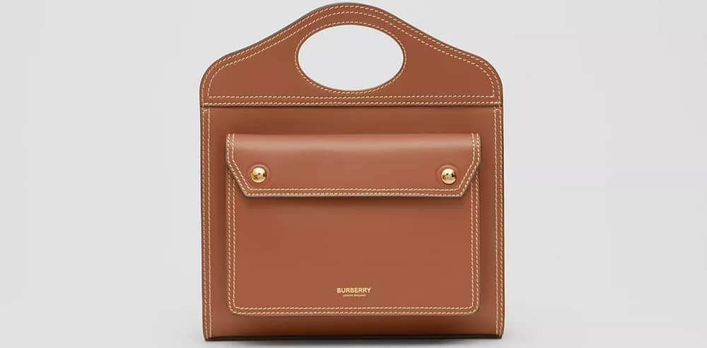 The Mini Topstitched Leather Pocket Bag in brown from Burberry.