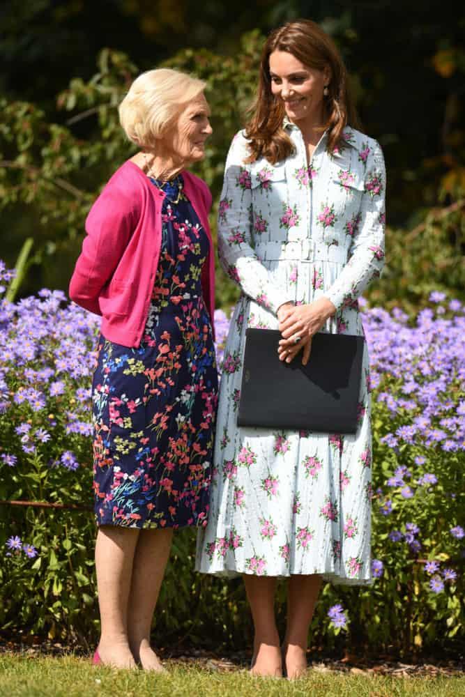 Two women wearing elegant dresses in floral pattern.