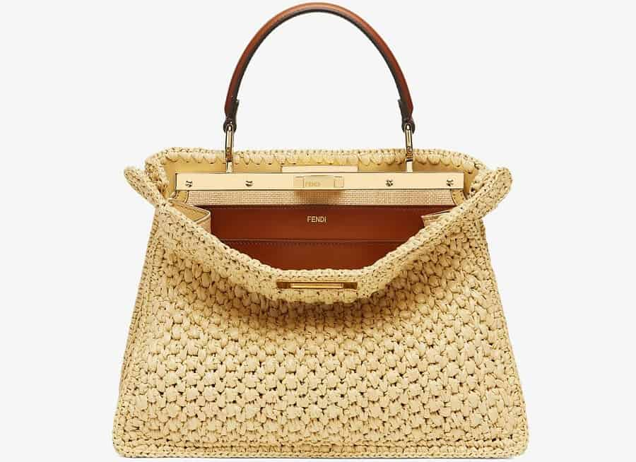 The Fendi Woven Straw handbag with leather interior and gold accents.