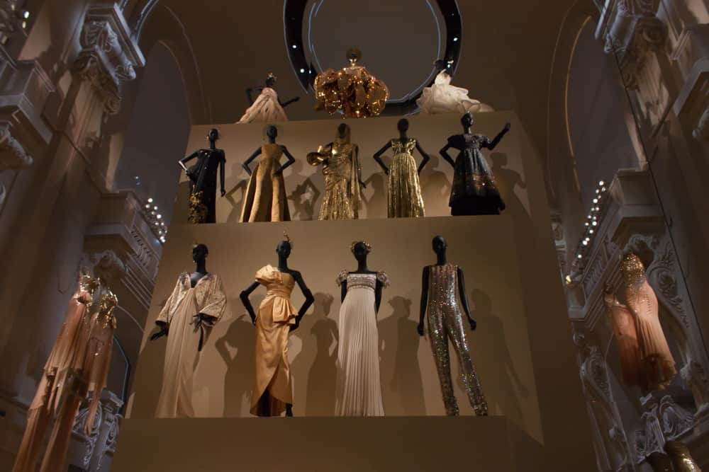 Dresses designed by Christian Dior presented in an exhibition.