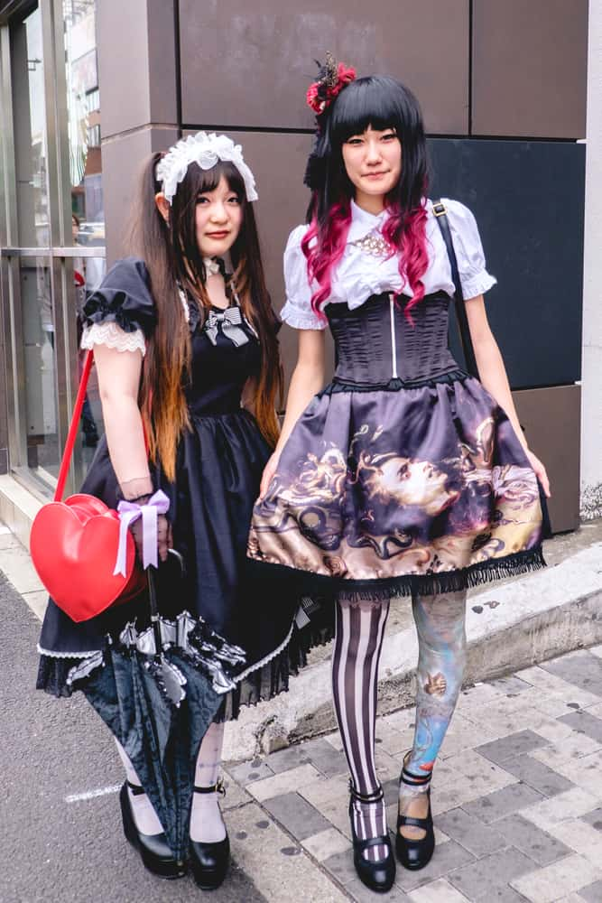 Japanese girls in gothic lolita style outfits.