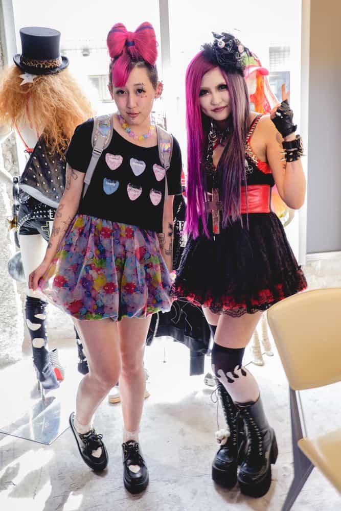 Japanese girls wearing lolita outfits.