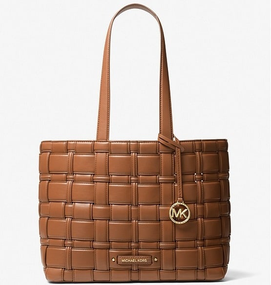 The brown Ivy Medium Woven Tote Bag from Michael Kors.