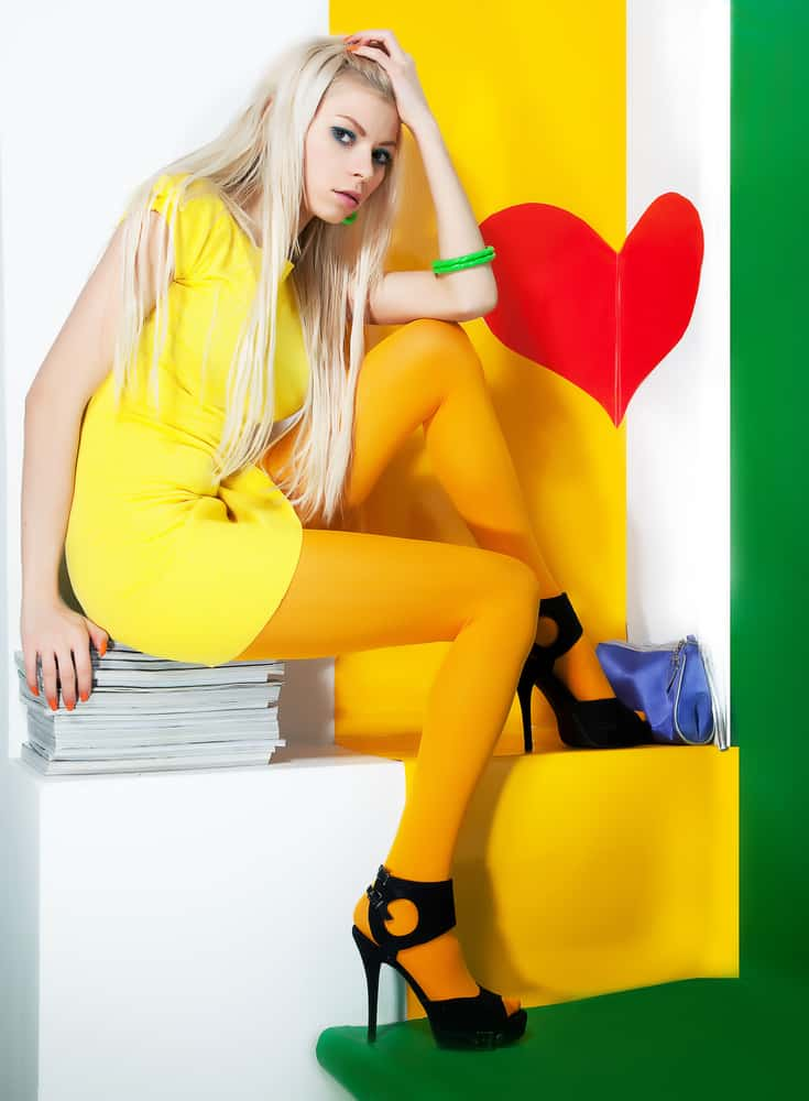 Model wearing a bright yellow dress and leggings.