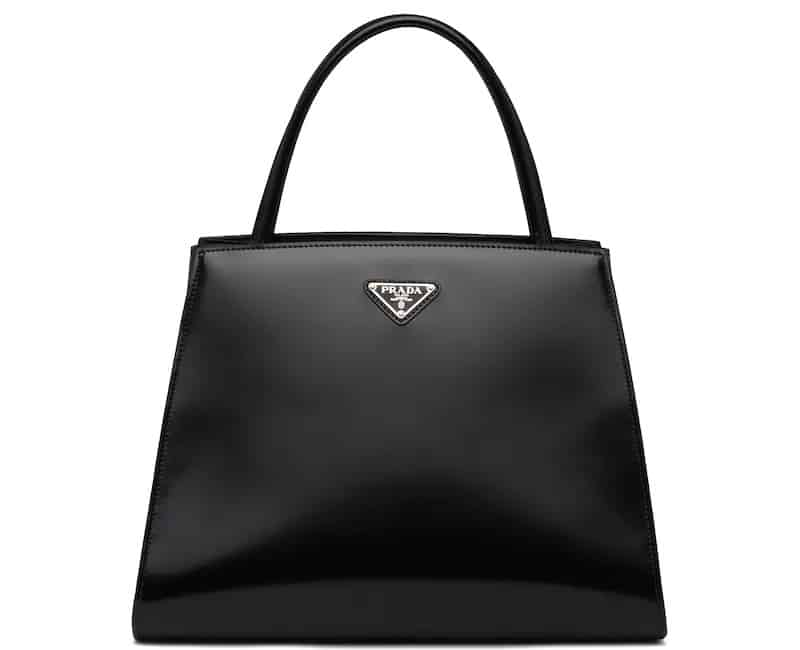 This is a black brushed leather handbag from Prada.