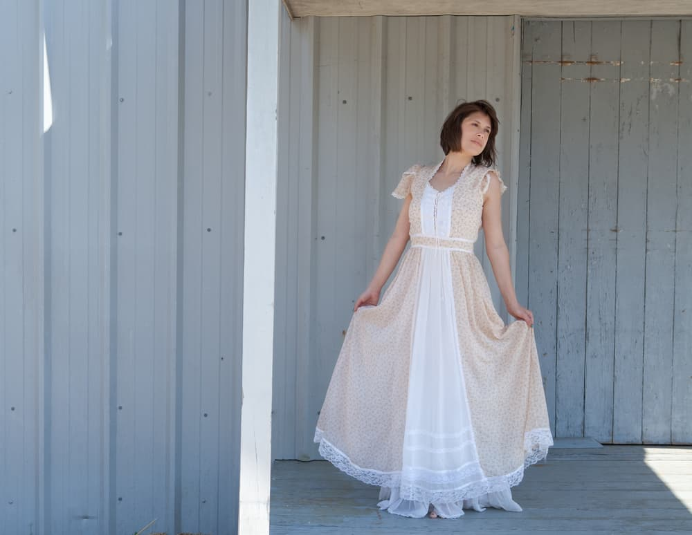Woman wearing a prairie chic dress.