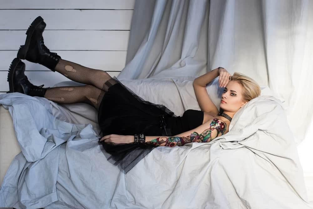 Punk girl lying on a sofa.