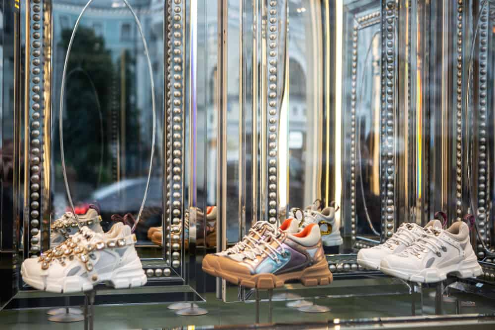 Various sneakers on display at a store.