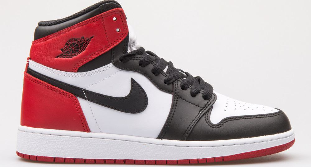 This is a close look at a Nike Air Jordan 1 Retro High OG BG white, black and red sneaker.