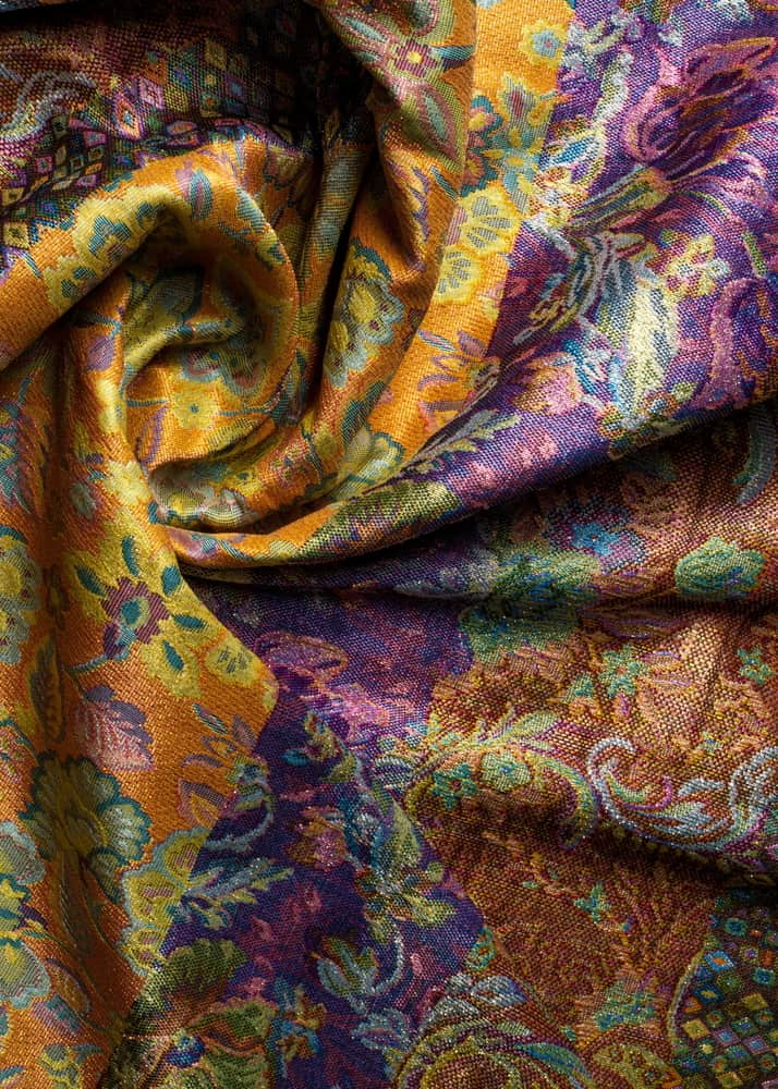 This is a close look at a colorful and patterned Damask Brocade fabric.