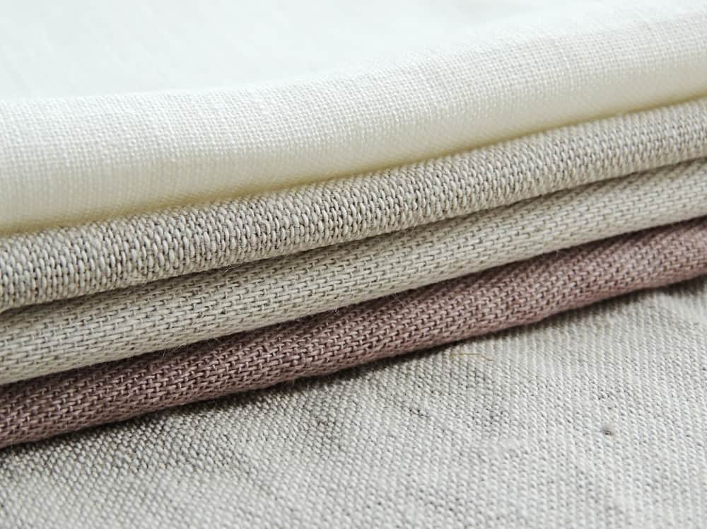 This is a close look at a stack of Linen Fabrics.