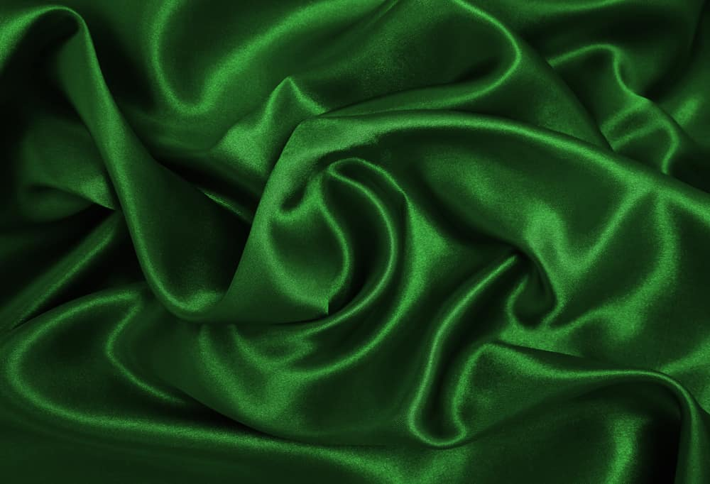 This is a close look at an emerald green silk fabric.