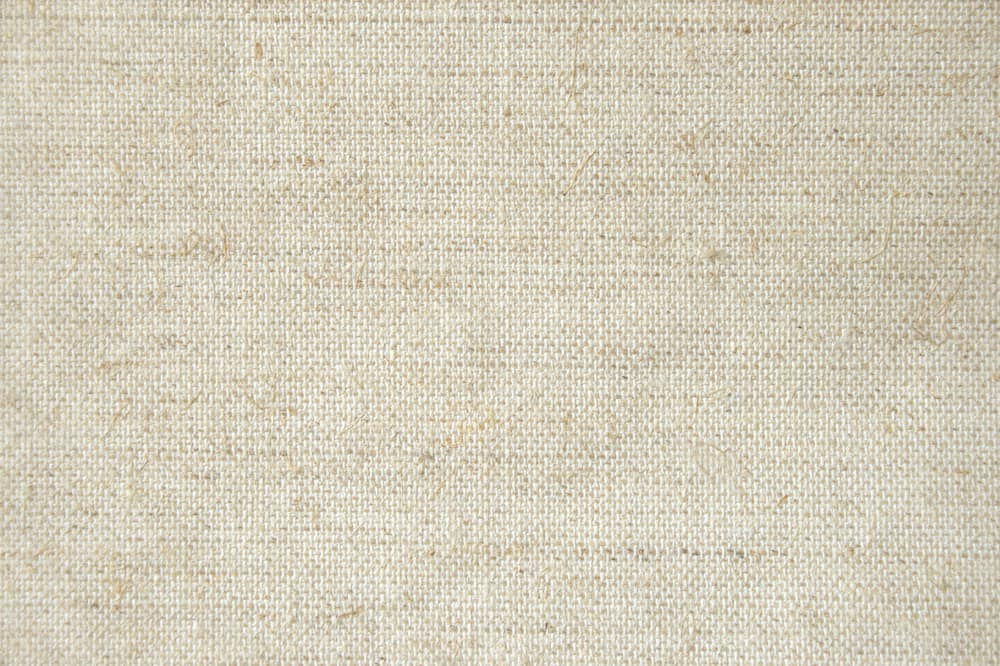 This is a close look at a beige muslin fabric.
