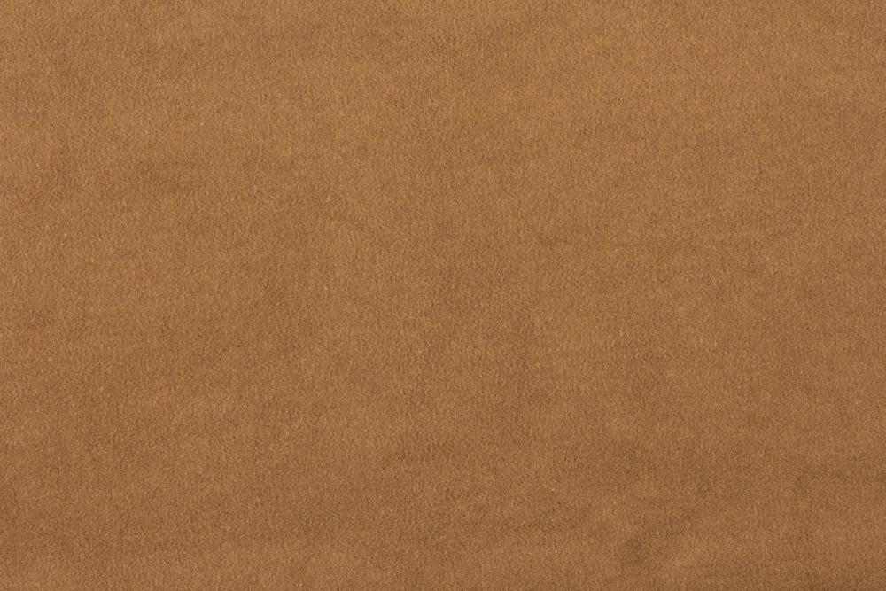This is a close look at a suede fabric with a brown tone.
