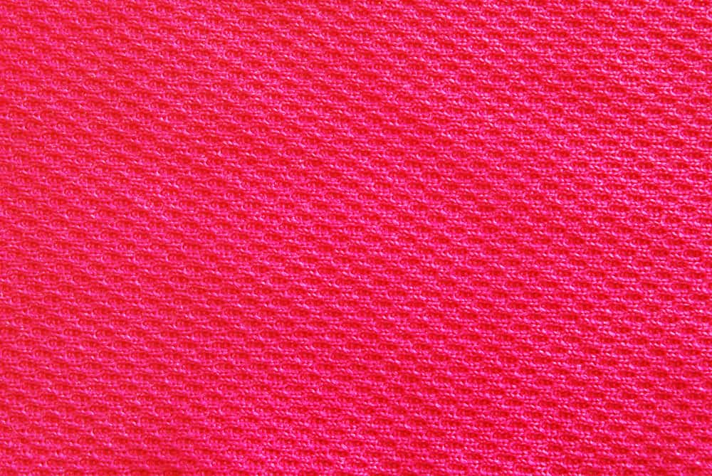 This is a close look at a bright red Interlock Knit fabric.