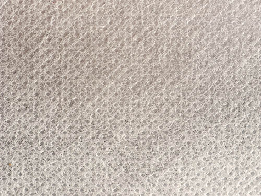 This is a close look at a white nonwoven polypropylene fabric.