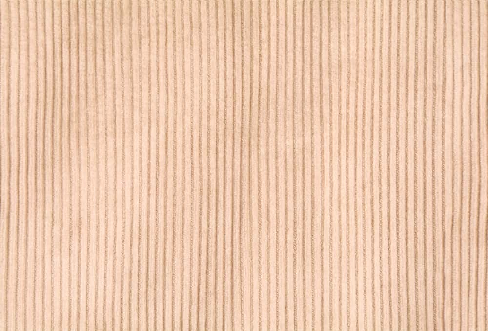 This is a close look at a patterned brown Corduroy fabric.