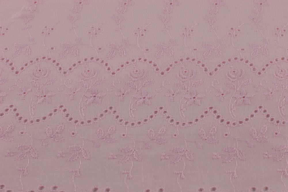 This is a close look at a textured Eyelet fabric.