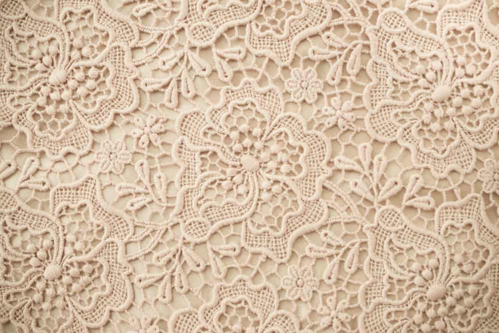 This is a close look at a patterned beige Lace fabric.