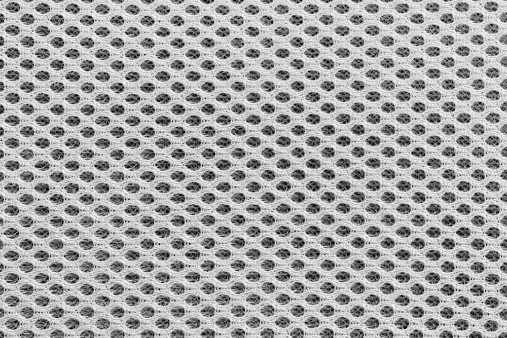 This is a close look at a white textured Mesh fabric.