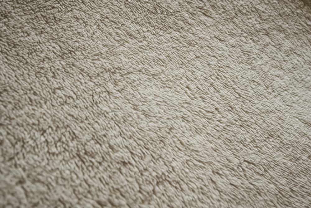 This is a close look at a beige Micro-Fleece fabric.