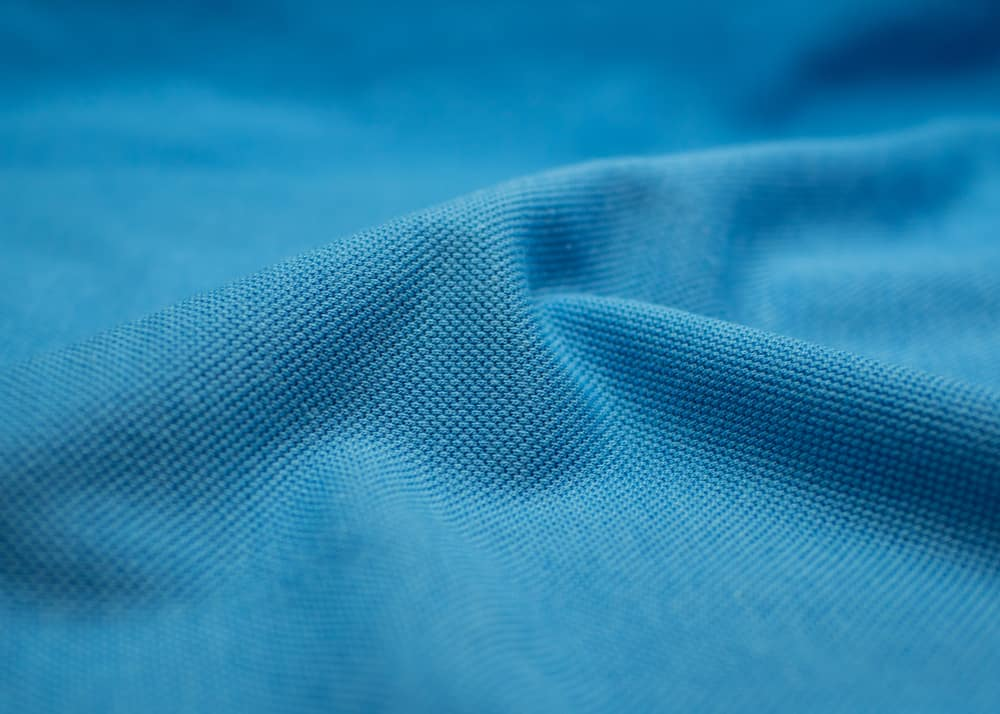 This is a close look at a blue Pique fabric.