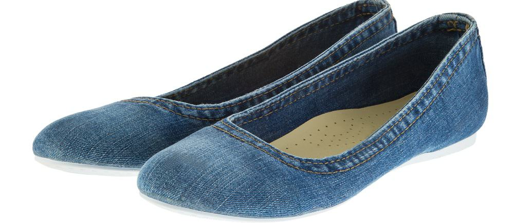 This is a close look at a pair of shoes made of Denim.
