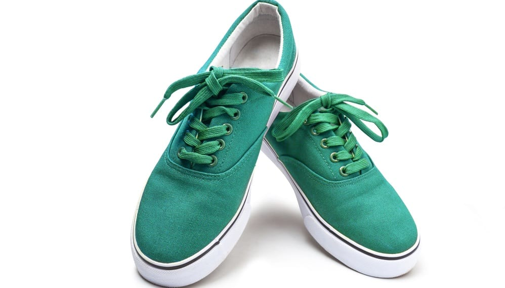 This is a pair of green sneakers made of Canvas.