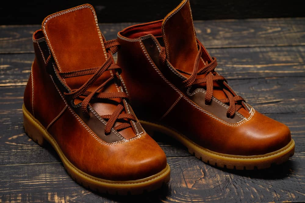 This is a close look at a pair of trendy brown leather laced boots.