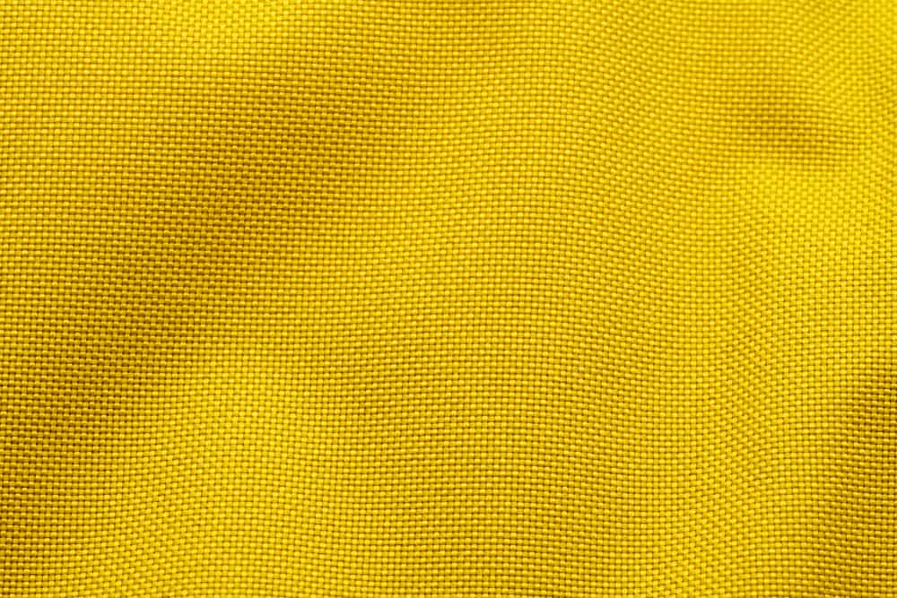 This is a close look at a yellow Nylon fabric.