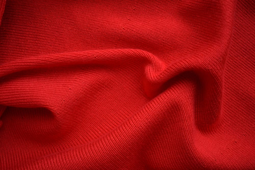 This is a close look at a red acrylic fabric.