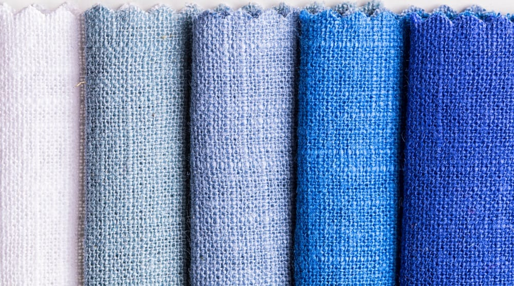 These are various linen fabrics in varying shades of blue.