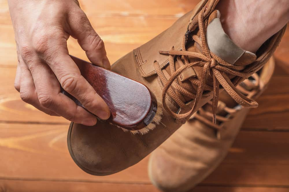 This is a close look at a man brushing his Nubuck leather shoes.