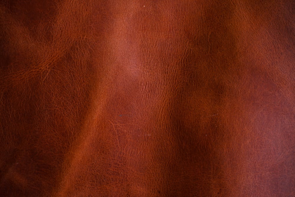 This is a close look at a piece of brown Vegetable Tanned Leather fabric.