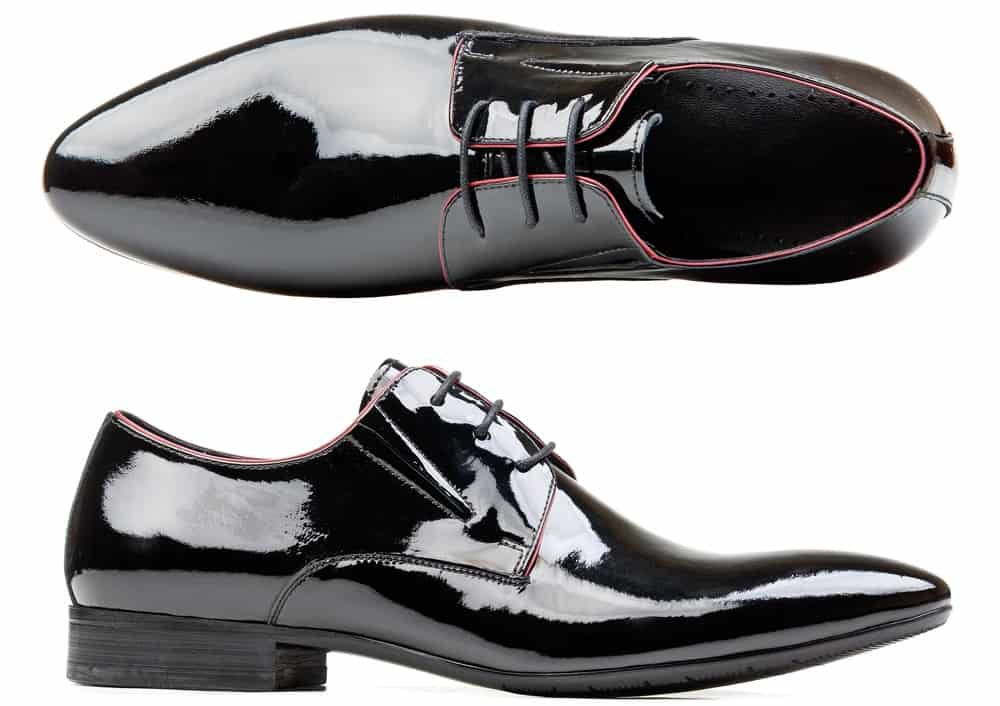 This is a pair of shiny black leather Patent Leather shoes.