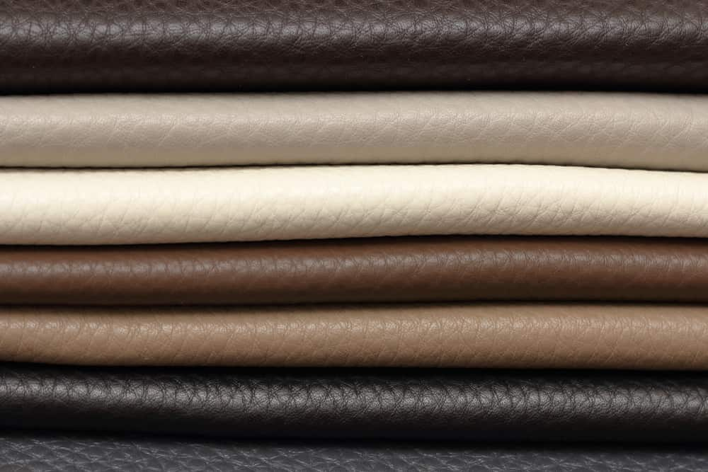 This is a close look at a stack of various Calfskin leather fabrics.