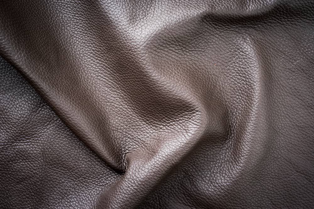 This is a close look at a piece of dark brown Boxcalf leather fabric.