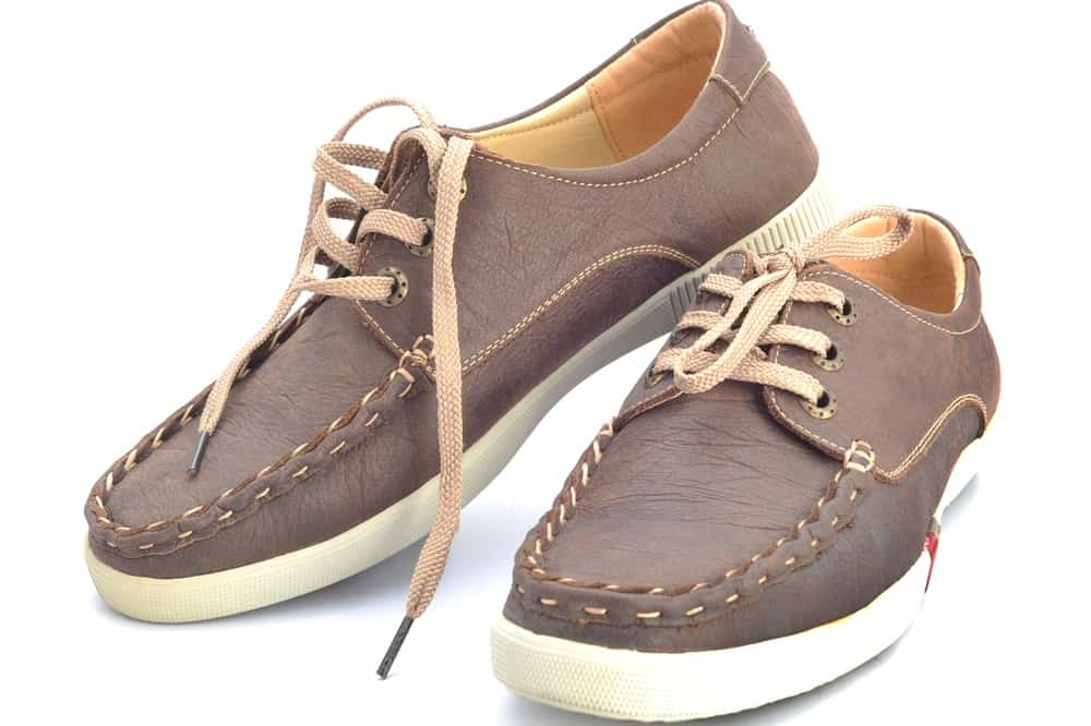 This is a close look at a pair of brown Cowhide shoes.