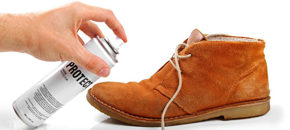 This is a close look at a man maintaining his Suede shoe.