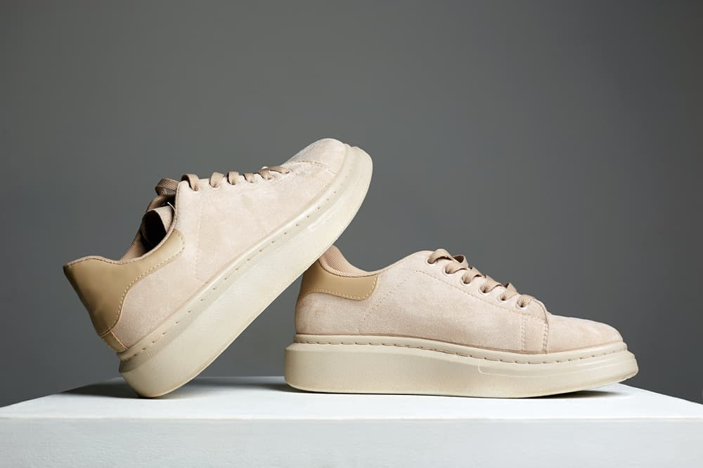 This is a close look at a pair of Cowhide Suede leather sneakers.