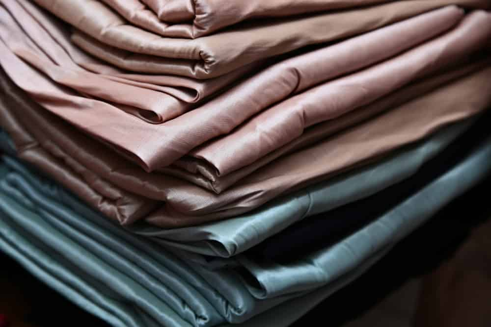 This is a close look at a stack of various special rayon fabrics.