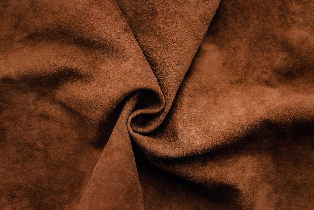 This is a close look at a piece of genuine brown suede fabric.