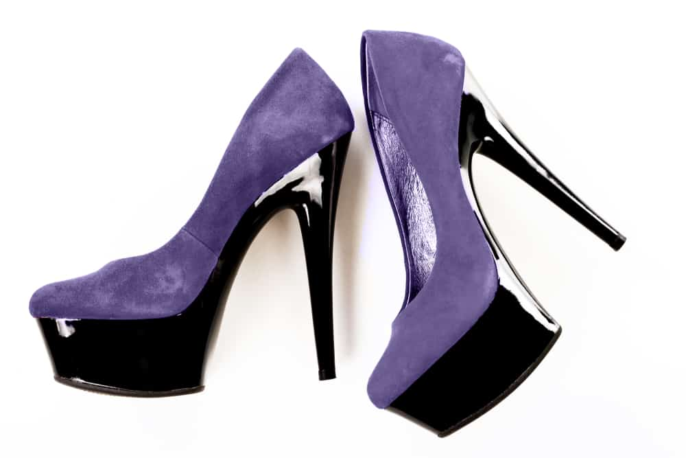 This is a close look at a pair of purple ultrasuede heels.