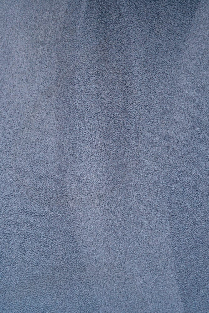 This is a close look at a blue gray velour leather.