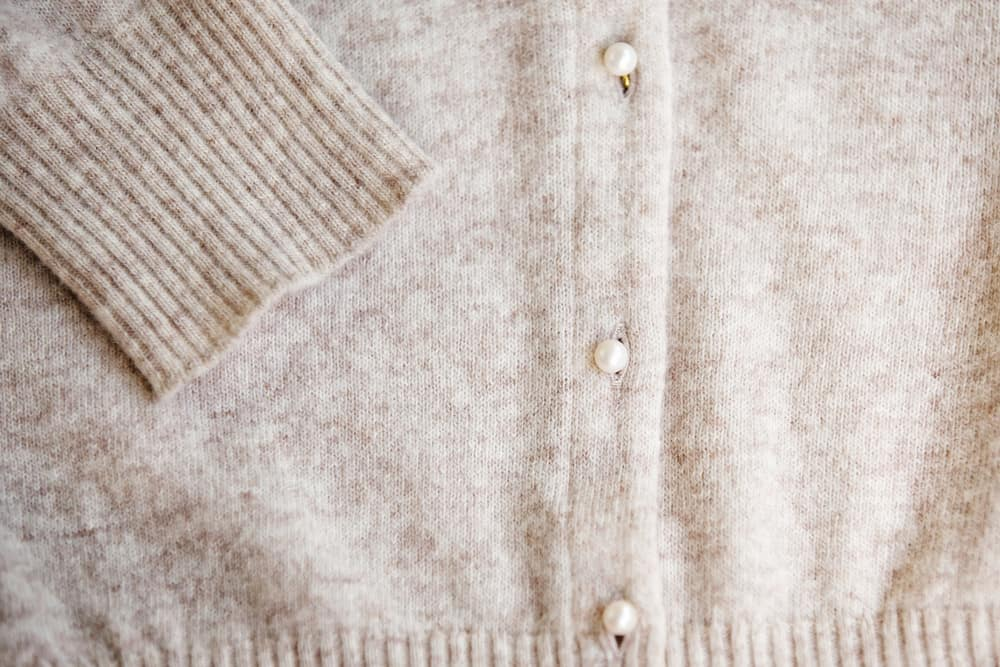 This is a close look at a beige Angora Wool cardigan.