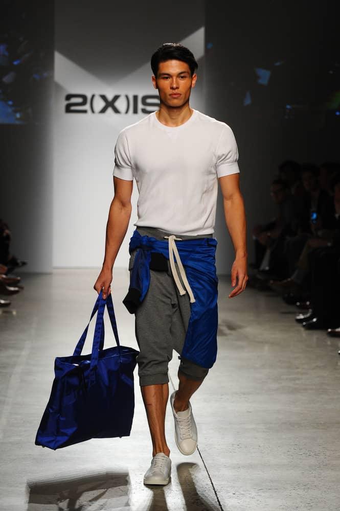 Man in an athleisure look walks the runway.