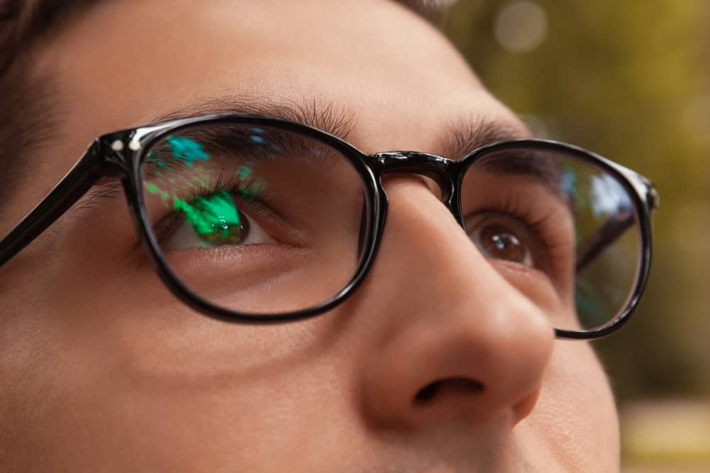 This is a close look at a man wearing a pair of glasses.